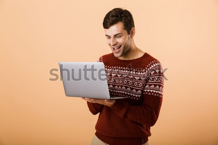 Young hipster with laptop isolated Stock photo © deandrobot