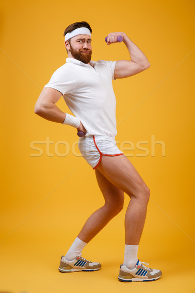 Vertical image of sportsman showing bicep Stock photo © deandrobot