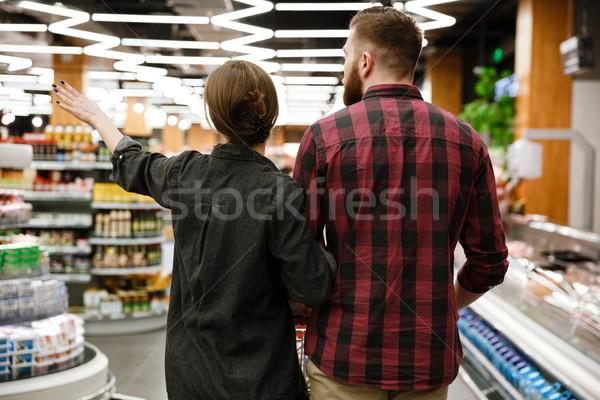 Hátulnézet fiatal szerető pár áruház választ Stock fotó © deandrobot