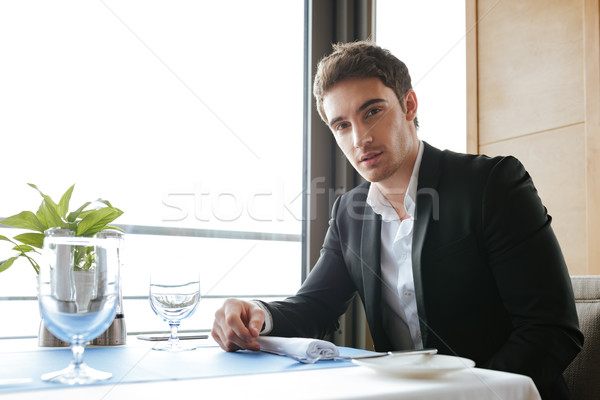 Side view of Calm Man in restaurant Stock photo © deandrobot