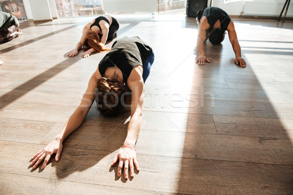 Grup insanlar yoga stüdyo kız Stok fotoğraf © deandrobot