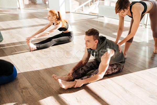 Persone gruppo yoga istruttore studio donna Foto d'archivio © deandrobot
