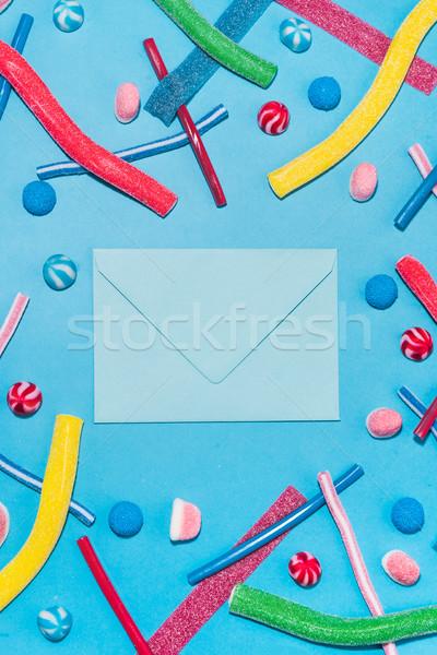 Felső kilátás színes cukor cukorkák boríték Stock fotó © deandrobot