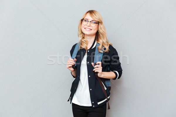 Happy young lady student Stock photo © deandrobot