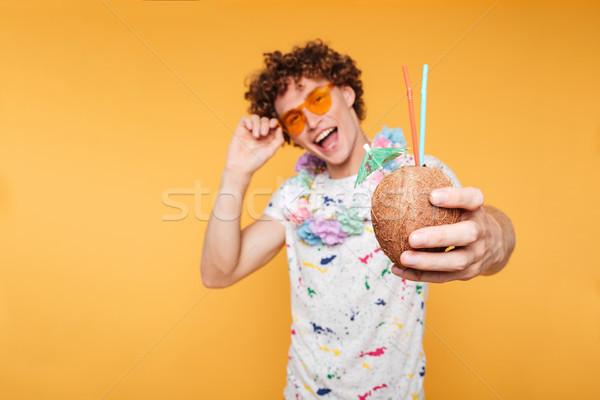 Mutlu genç adam güneş gözlüğü hindistan cevizi Stok fotoğraf © deandrobot