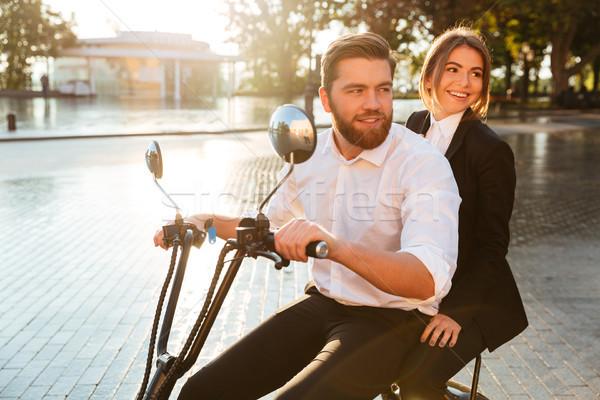 вид сбоку улыбаясь бизнеса пару современных мотоцикле Сток-фото © deandrobot