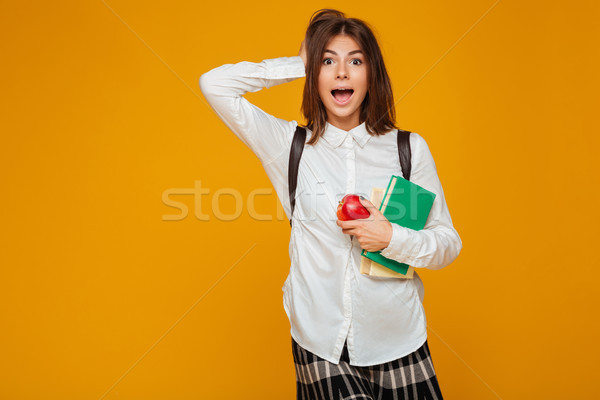 Portret opgewonden schoolmeisje boeken appel Stockfoto © deandrobot