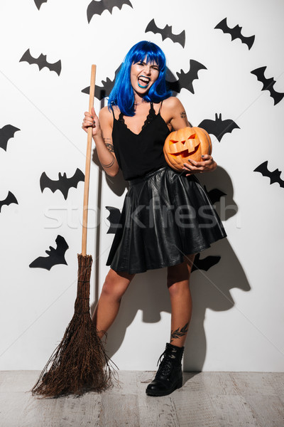 Gorgeous young woman in witch halloween costume Stock photo © deandrobot