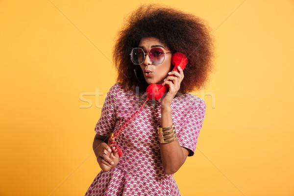 Portrait of a pretty afro american woman Stock photo © deandrobot