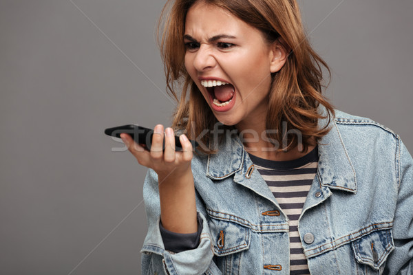 Close up portrait of an angry stressed teenage girl Stock photo © deandrobot