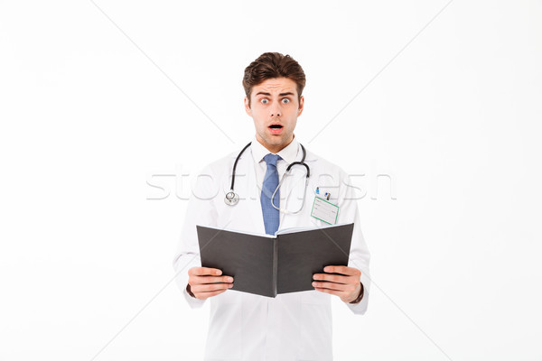 Portrait of an astonished young male doctor Stock photo © deandrobot