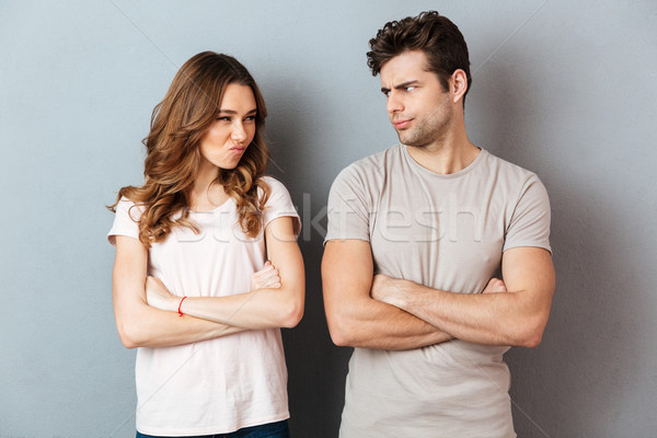 Upset disappointed couple standing with arms Stock photo © deandrobot