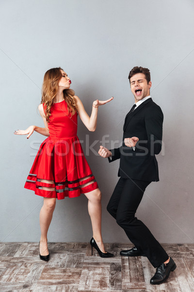 Full length portrait of a happy cheery couple Stock photo © deandrobot