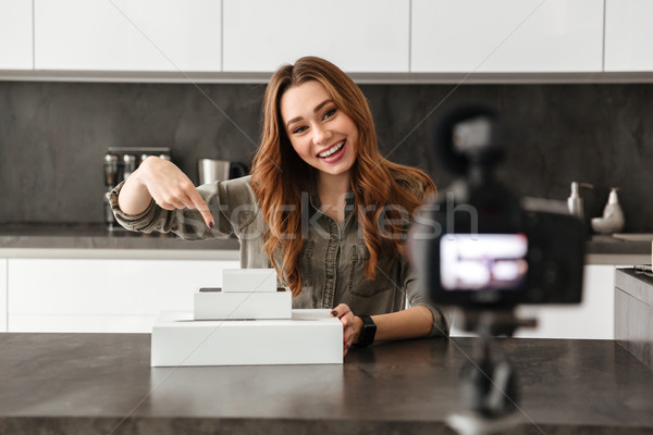 Happy young girl recording her video blog episode Stock photo © deandrobot