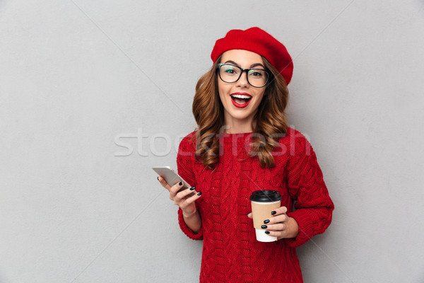 Portrait of a joyful woman dressed in red sweater Stock photo © deandrobot