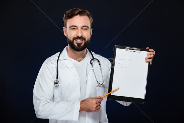 Portrait souriant médecin de sexe masculin uniforme vert Photo stock © deandrobot