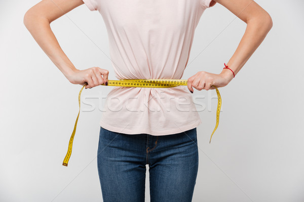 Mince femme mètre à ruban autour Photo stock © deandrobot