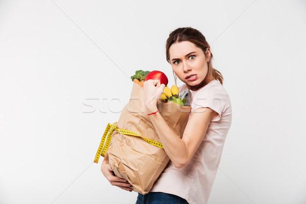 портрет жадный девушки сумку Сток-фото © deandrobot