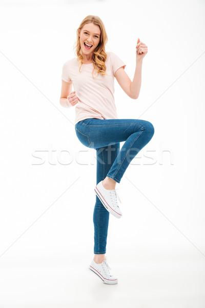 Szczęśliwy młoda kobieta zwycięzca gest obraz Zdjęcia stock © deandrobot