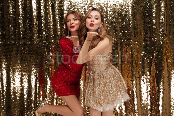 Portrait of two beautiful playful women Stock photo © deandrobot