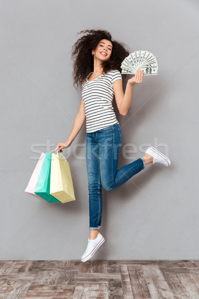 Brunette female in casual posing with a lot of packages and fan  Stock photo © deandrobot