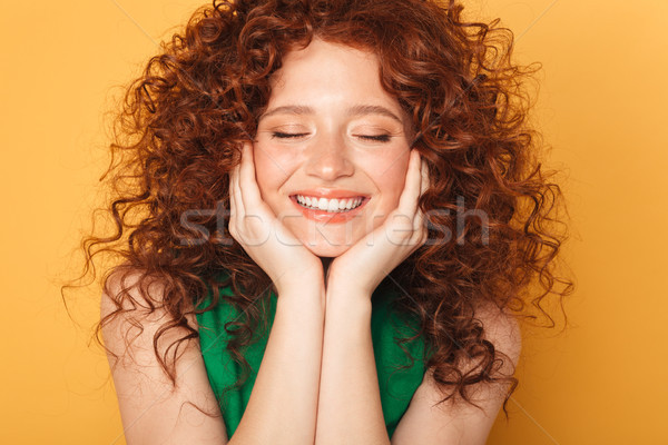 Közelkép portré mosolyog fürtös vörös hajú nő nő Stock fotó © deandrobot