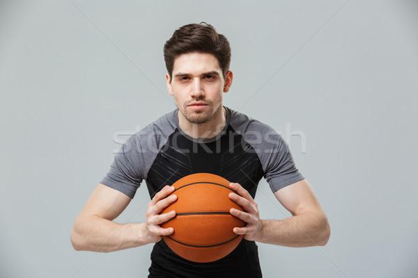 портрет концентрированный молодые спортсмен играет баскетбол Сток-фото © deandrobot