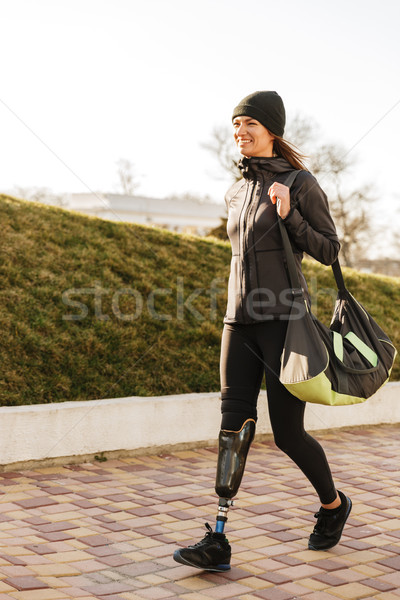 Photo of young athletic disabled girl with prosthetic leg in spo Stock photo © deandrobot