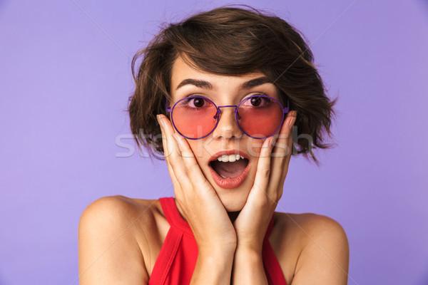 удивленный счастливым довольно брюнетка женщину Солнцезащитные очки Сток-фото © deandrobot