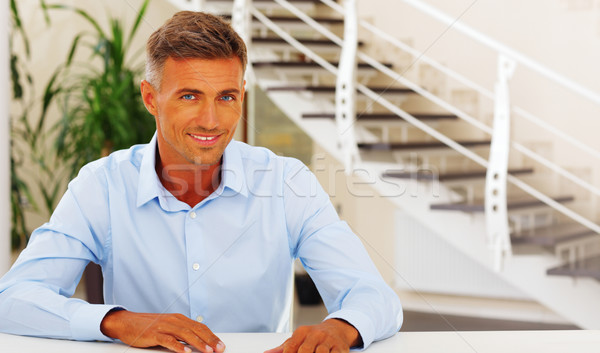 Happy handsome mature man in formal cloths at home Stock photo © deandrobot