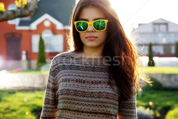 Portrait of a beautiful woman in fashionable sunglasses Stock photo © deandrobot