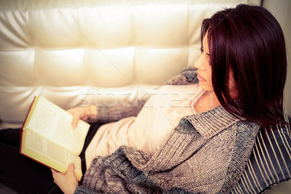 Woman in casual cloths reading a book at home Stock photo © deandrobot