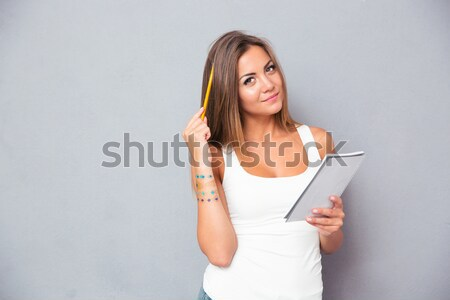 Happy woman making photo on smartphone Stock photo © deandrobot