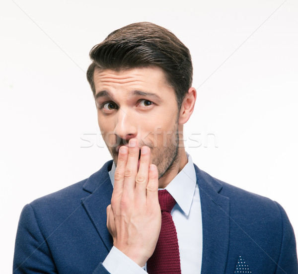 Businessman covering his mouth Stock photo © deandrobot