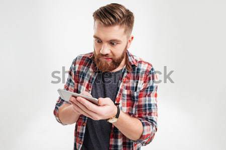 Upset young man crying and holding credit card Stock photo © deandrobot