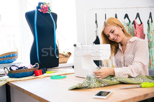 Kadın dikiş makinesi güzel genç kadın çamaşırhane iş Stok fotoğraf © deandrobot