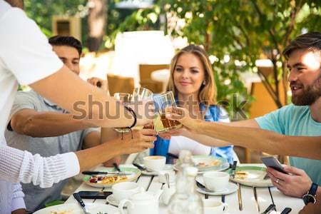 Friends enjoying outdoor dinner party Stock photo © deandrobot