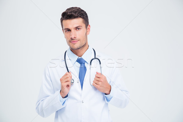 Portrait of a male doctor standing with stethoscope Stock photo © deandrobot