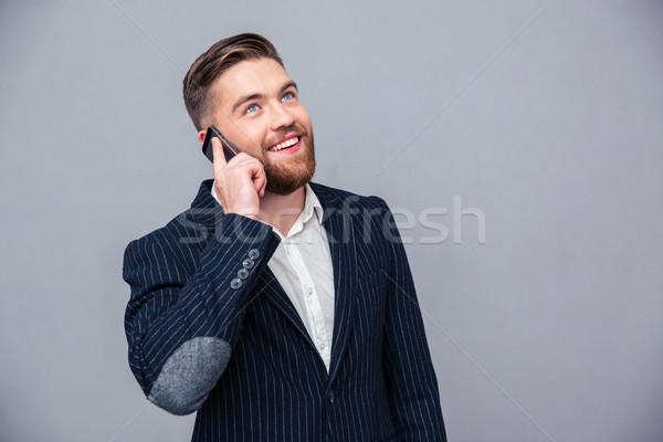 Boldog figyelmes üzletember beszél telefon portré Stock fotó © deandrobot