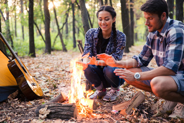 Happy couple and bonfire Stock photo © deandrobot