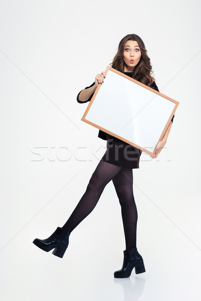 Beautiful young girl posing with blank board Stock photo © deandrobot