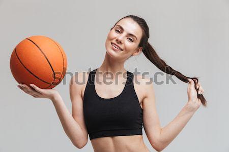 Сток-фото: улыбаясь · спортивных · женщину · баскетбол · мяча