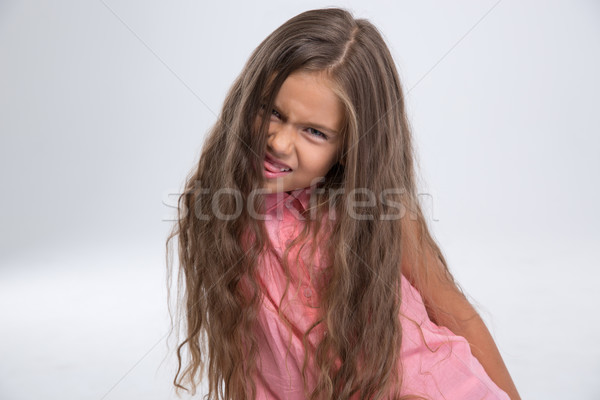 Portrait of a little girl fooling around  Stock photo © deandrobot