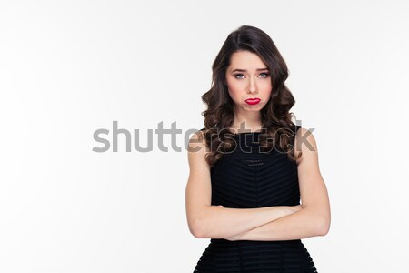 Stock photo: Cute offended sad girl with bright makeup in retro style