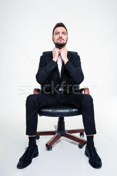肖像 深刻 濃縮された ビジネスマン 黒 事務椅子 ストックフォト © deandrobot