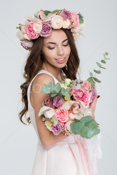 очаровательный невеста венок роз глядя букет Сток-фото © deandrobot