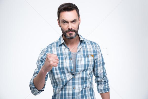 Stockfoto: Man · tonen · vuist · geïsoleerd · witte · succes