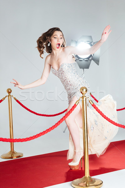 Woman falling on red carpet Stock photo © deandrobot
