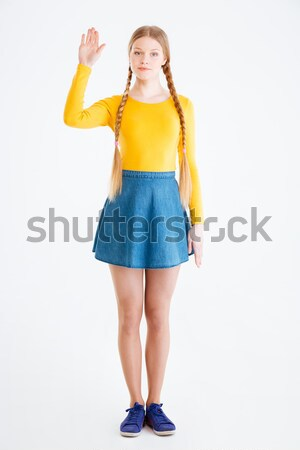 Woman showing greeting sign with palm Stock photo © deandrobot