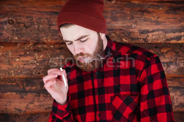 Man roken houten achtergrond rook Stockfoto © deandrobot